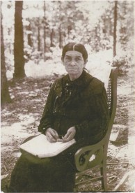 Alethia 'Leitha' DICKERSON HOLDER in rocker outside, book in hand no glasses