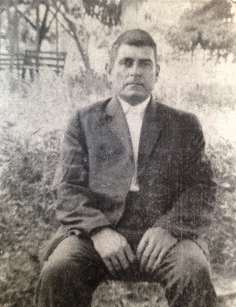 James Solomon HOLDER sitting outside