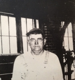James Solomon HOLDER in overalls at blacksmith shop