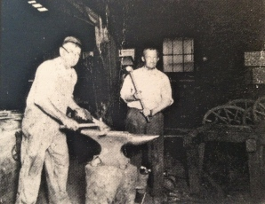 James Solomon HOLDER at anvil in blacksmith shop