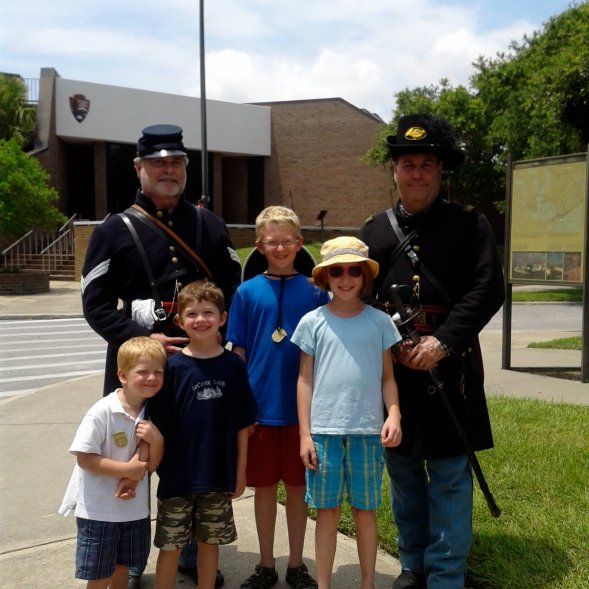 Two Civil War Reenactment Soldiers Pose with Children
