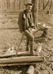Man resting after chopping wood